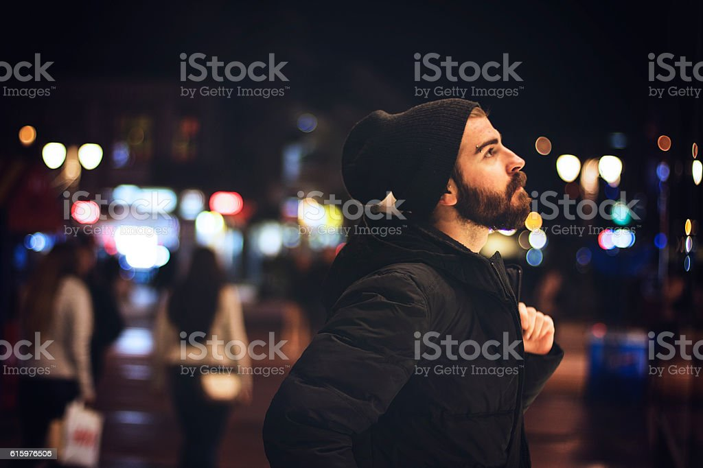 Bearded man in the city at night stock photo