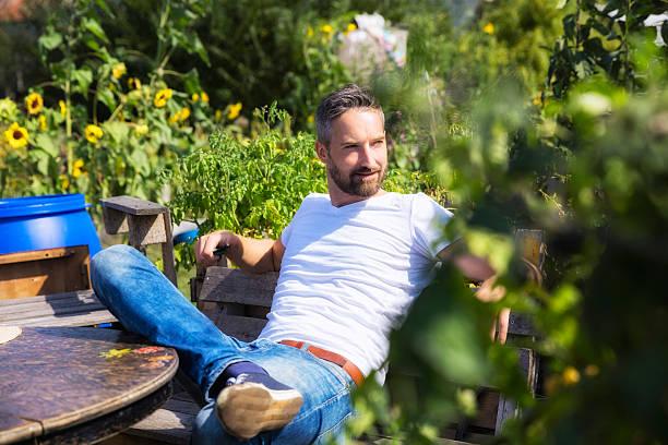 bearded man in urban garden stock photo