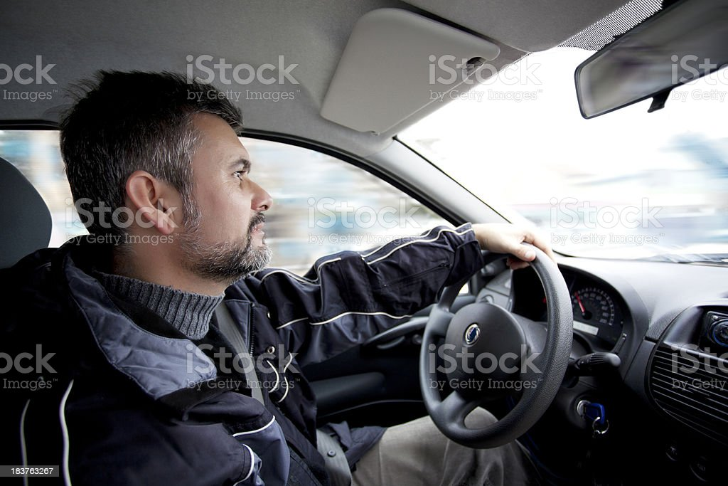 Bearded man looking concerned while driving car royalty-free stock photo