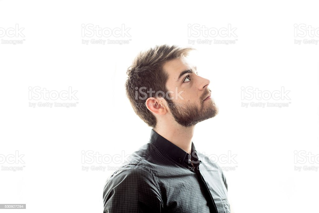 Bearded man looking up, portrait stock photo