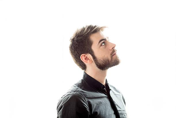 Bearded man looking up, portrait stock photo
