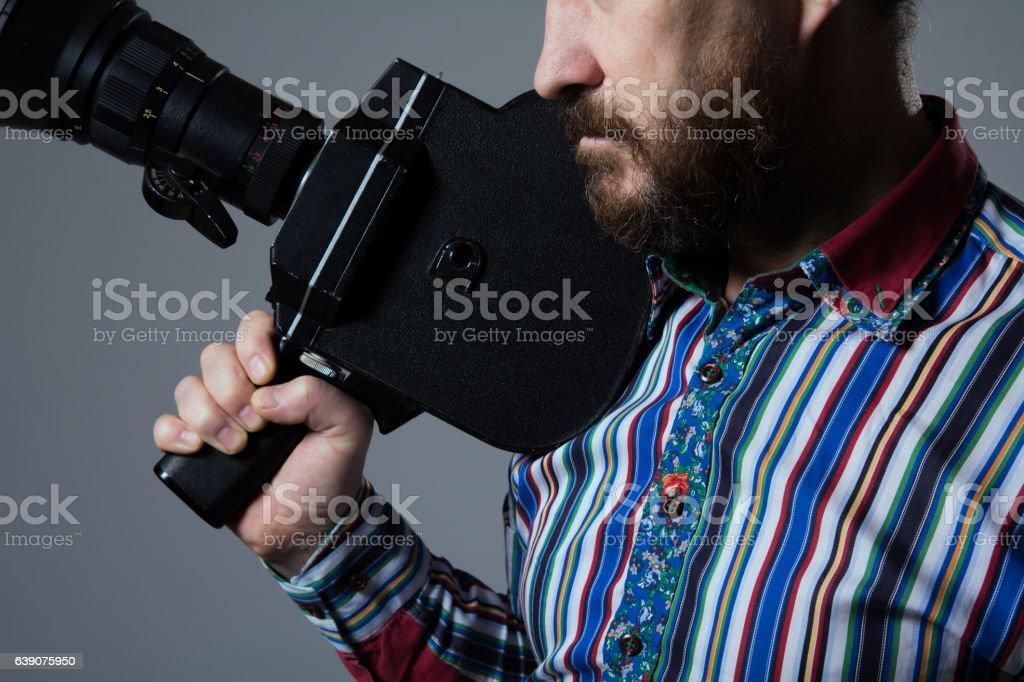 Bearded Man Movie Camera thoughtfully stock photo