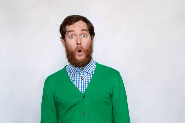 Bearded man opens his mouth in surprise stock photo