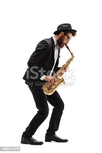 Full length profile shot of a bearded man playing a saxophone isolated on white background