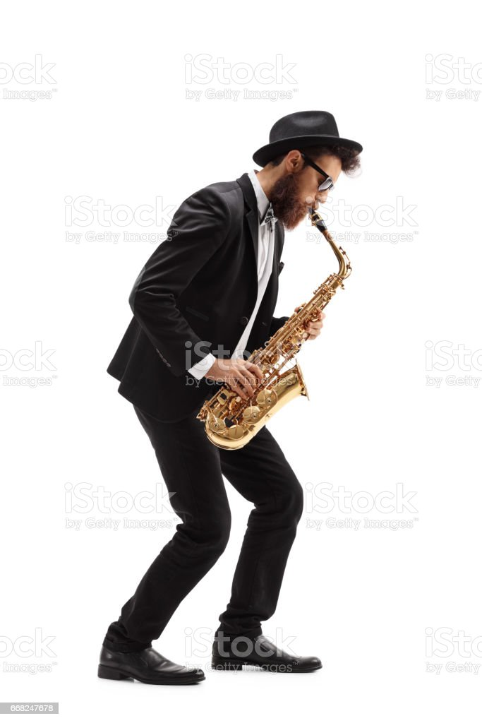 Bearded man playing a saxophone stock photo