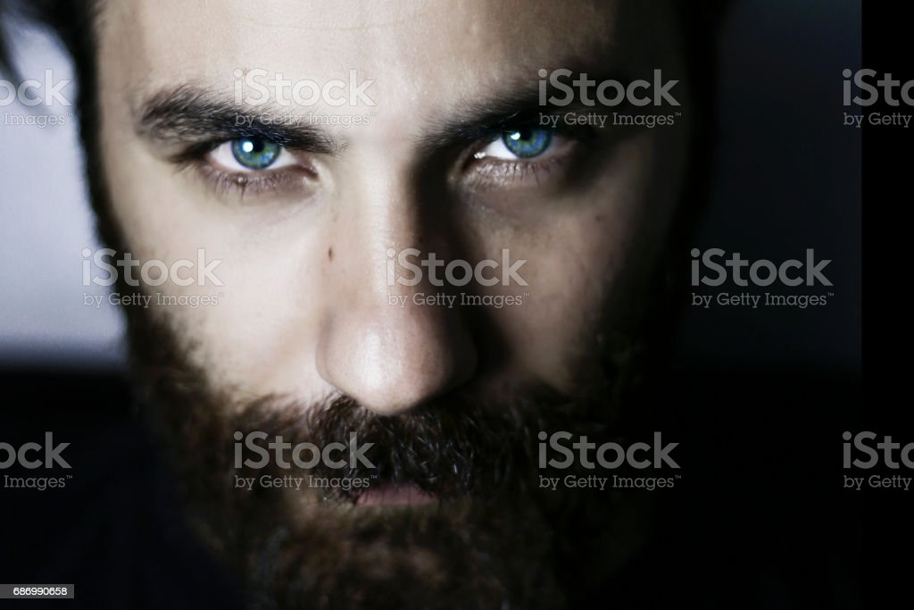 Bearded man portrait close-up blue eyes - Photo