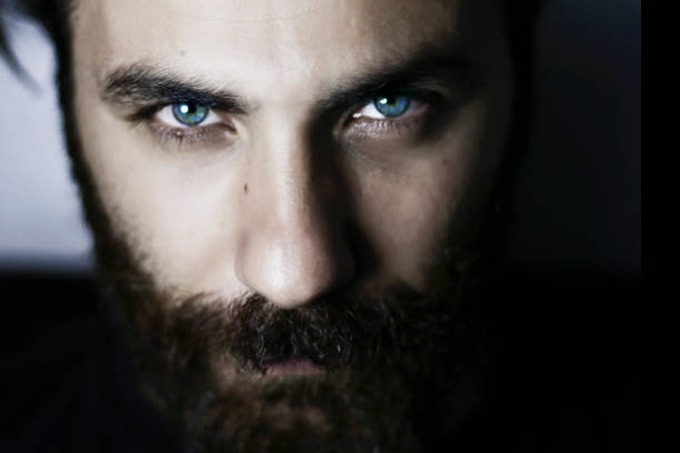 Bearded man portrait close-up blue eyes stock photo