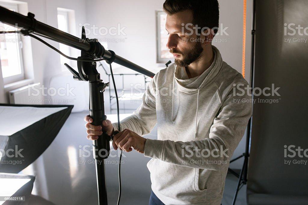 Bearded man setting photo equipment zbiór zdjęć royalty-free