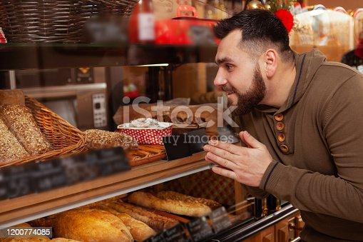 istock Bearded man shopping at the bakery 1200774085