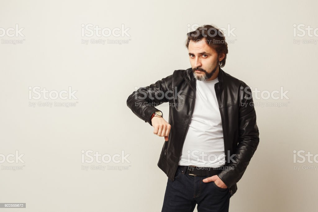 Bearded man showing his smart watch stock photo