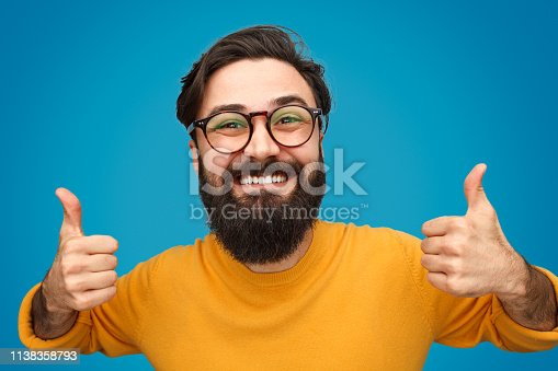 istock Bearded man showing thumbs up 1138358793