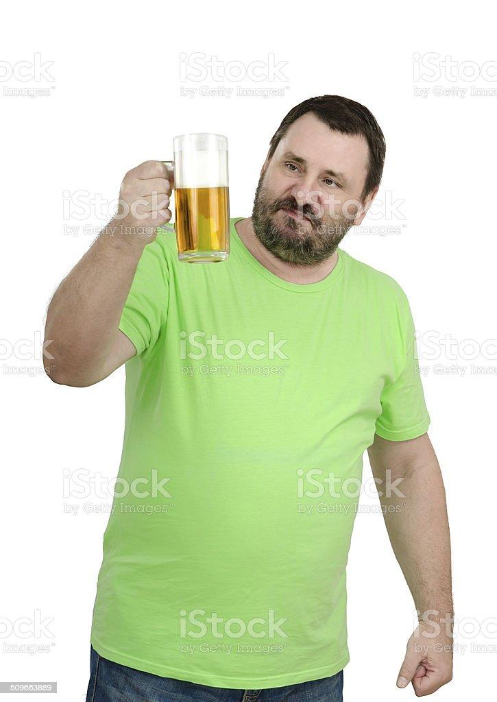 Bearded man staring at beer mug stock photo