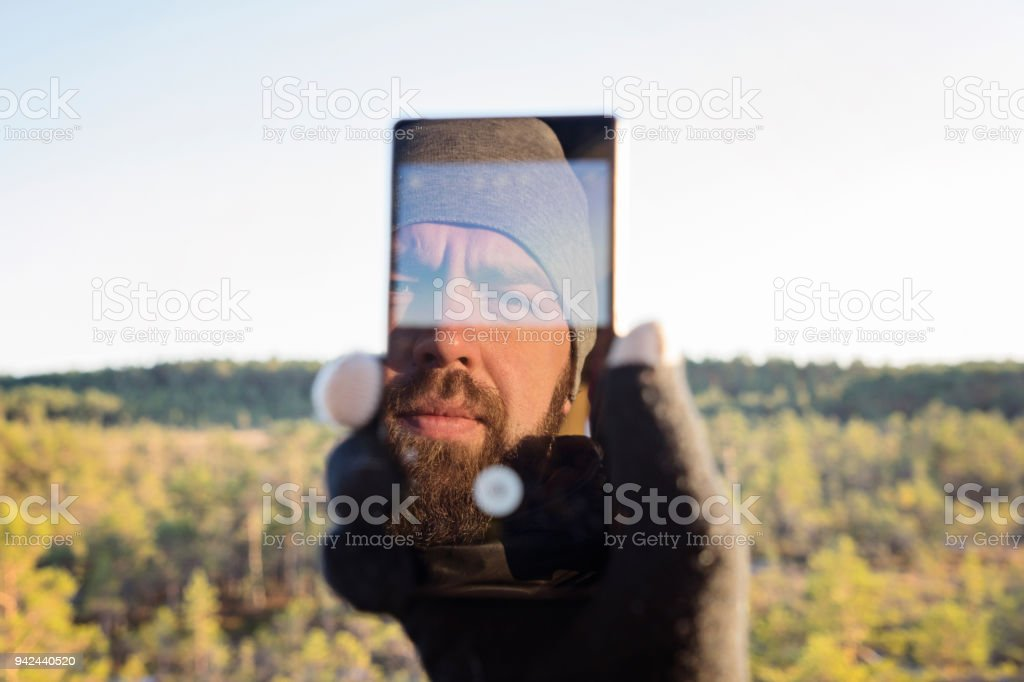 Bearded man taking selfie stock photo