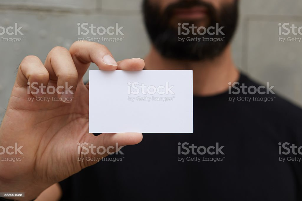 Bearded Man Wearing Casual Black Tshirt Showing Blank White Business стоковое фото