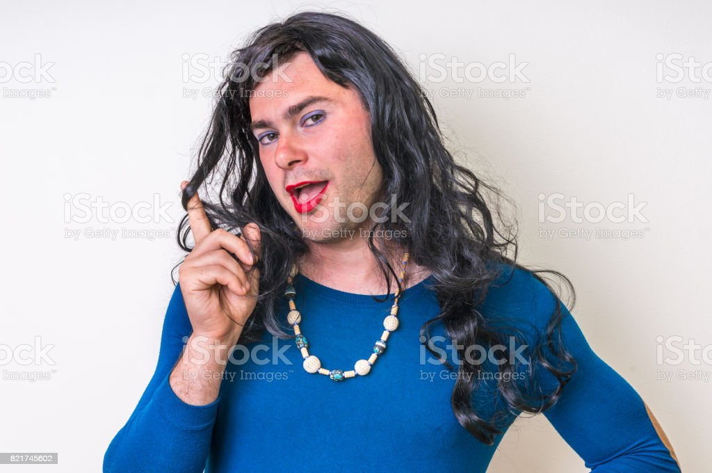 Bearded man wearing makeup and female dress stock photo