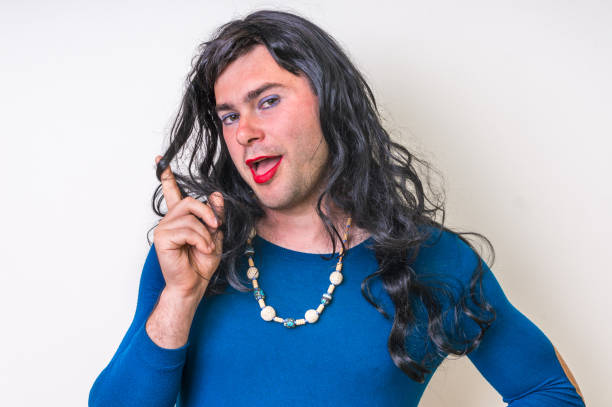 bearded man wearing makeup and female dress - transvestite stock photos and pictures