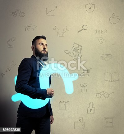 istock Bearded man with a dollar icon 856992836