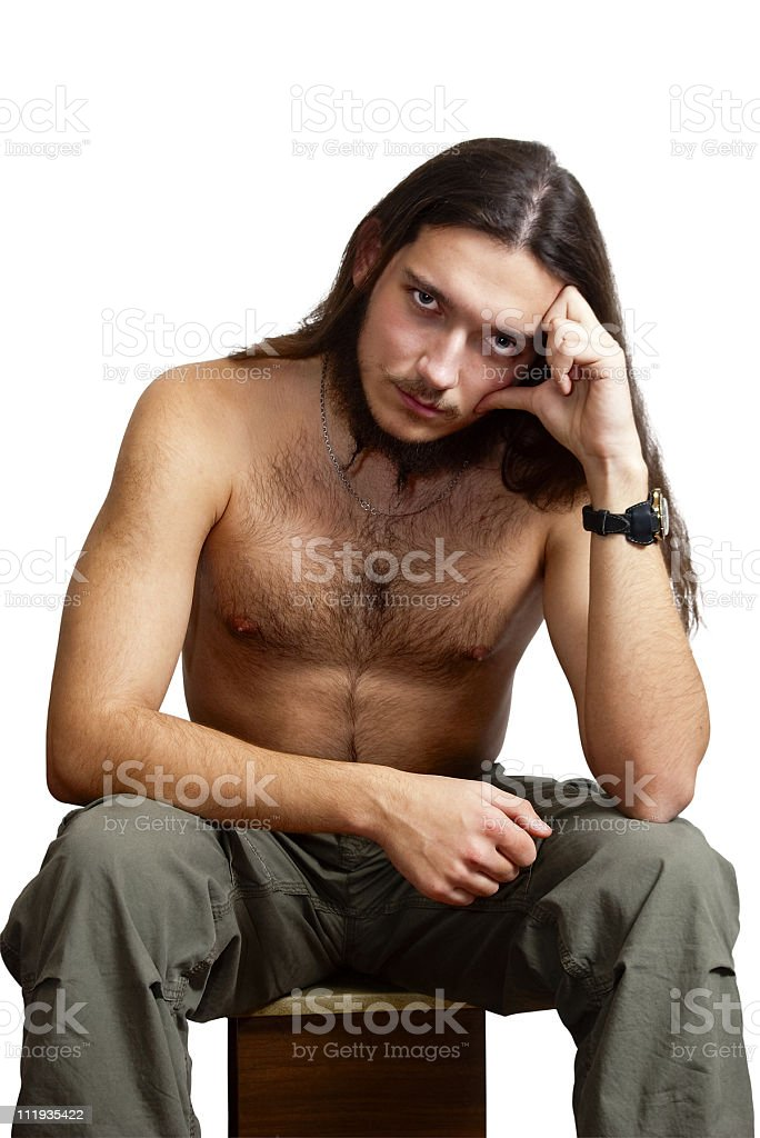 Bearded man with a naked torso. stock photo
