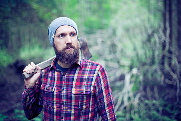 Bearded man with axe Bearded man with axe lumberjack stock pictures, royalty-free photos & images