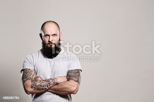 istock Bearded man with crossed arms 466083764