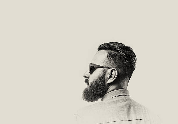 bearded man with glasses - beard stock pictures, royalty-free photos & images