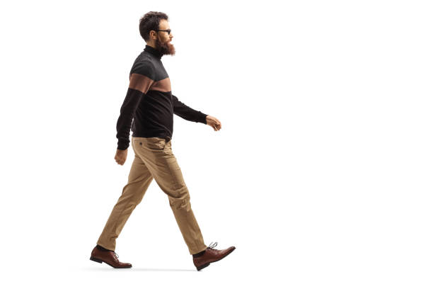 Bearded man with glasses walking Full length profile shot of a bearded man with glasses walking isolated on white background single step stock pictures, royalty-free photos & images