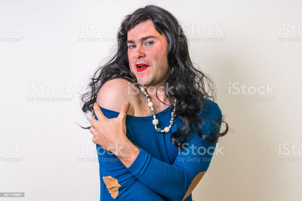 Bearded man with makeup showing sexy shoulder - foto stock