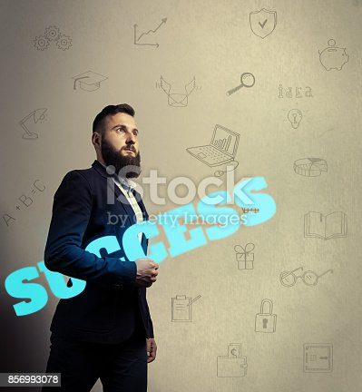 istock Bearded man with success icon 856993078
