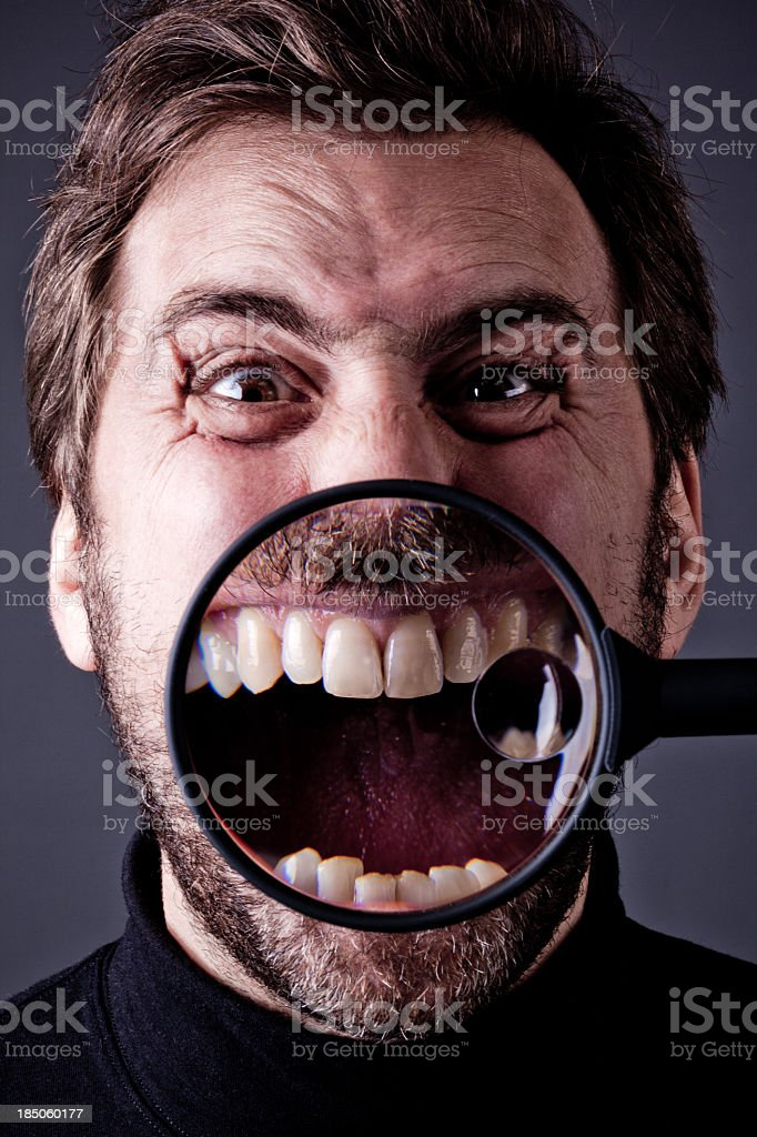 Bearded Man Yelling into Magnifying Glass stock photo