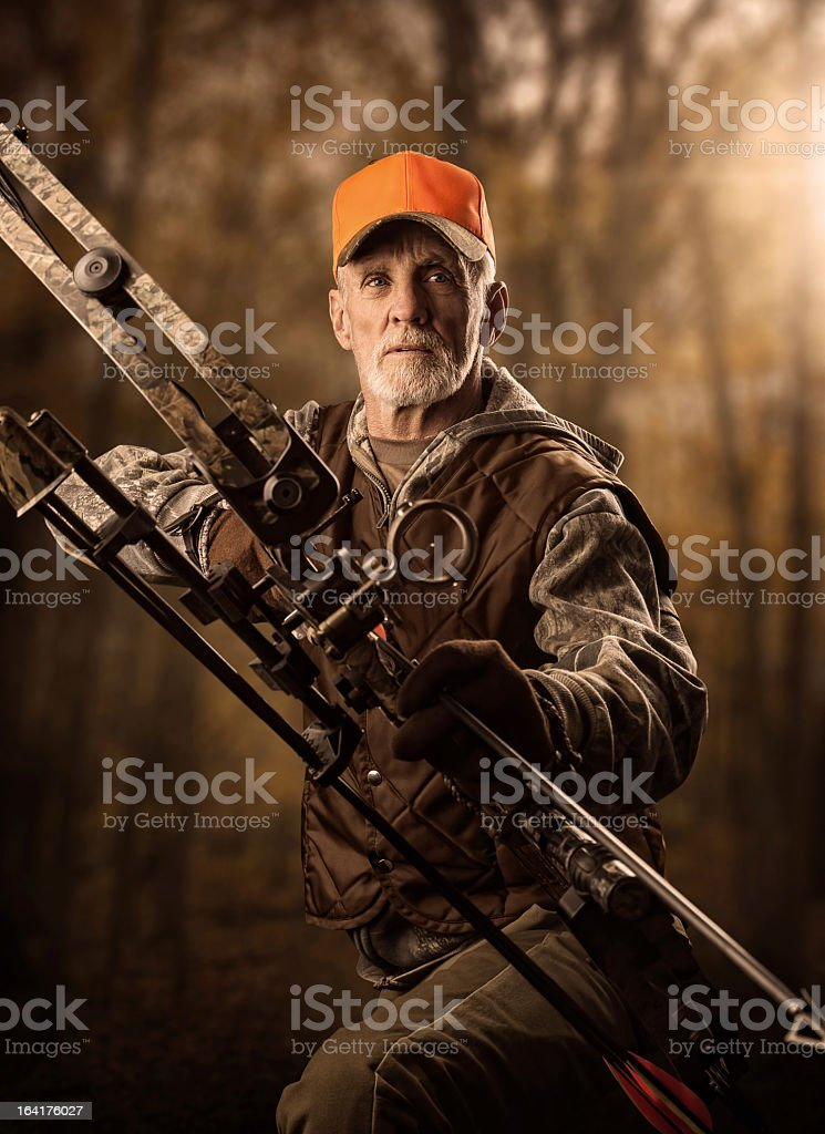 Bearded older male hunter with a crossbow stock photo