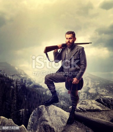 istock Bearded old-fashioned hunter in rocky mountain 658114236