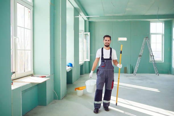 Bearded painter construction worker on a construction site. stock photo