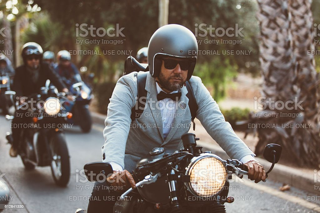Bearded rider on motorbike stock photo