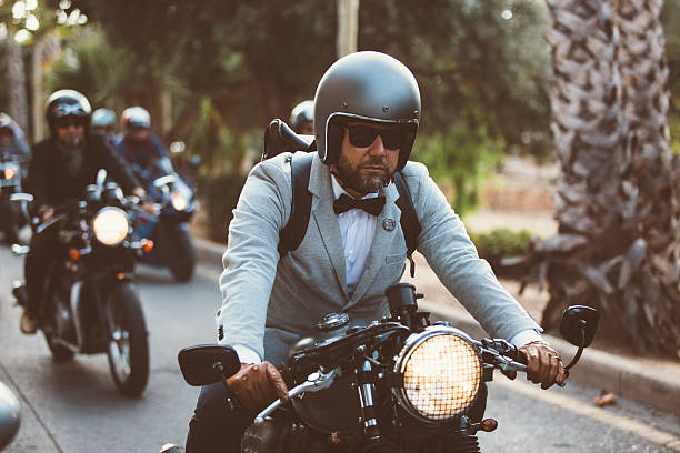 bearded rider on motorbike - motorbike racing stock photos and pictures