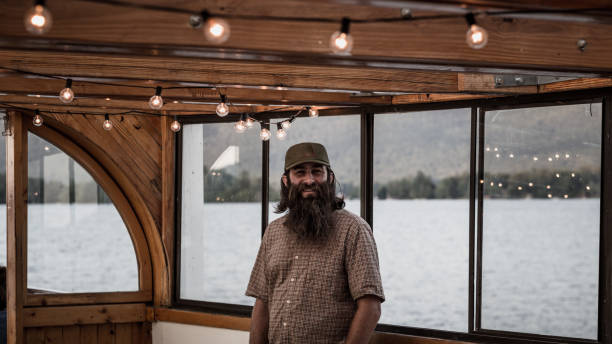 bearded sailor on wooden boat - katiedobies stock pictures, royalty-free photos & images
