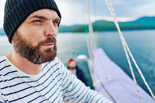 Bearded sailor Seaman squinting while looking into distance sailor suit stock pictures, royalty-free photos & images