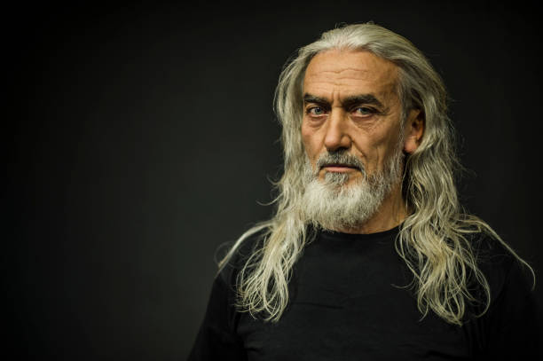 Bearded Senior Man Portrait, Age:55 Bearded Senior Man Portrait, Age:55 long hair stock pictures, royalty-free photos & images