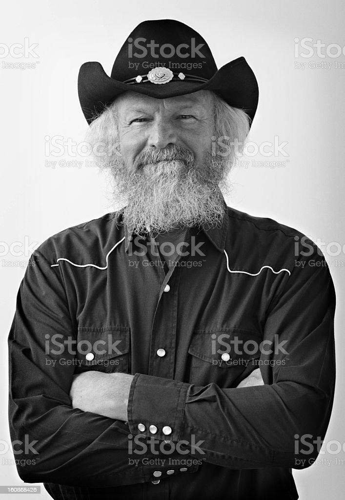 Bearded senior with cowboy attire stock photo
