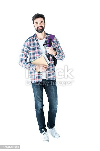 istock bearded student holding copybooks and looking at camera isolated on white 670007634