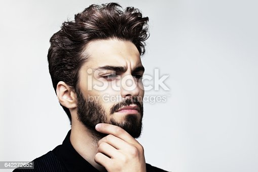 istock Bearded stylish man posing outdoors 642272652