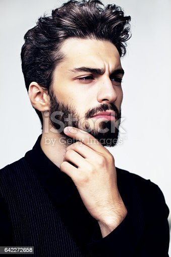 istock Bearded stylish man posing outdoors 642272658