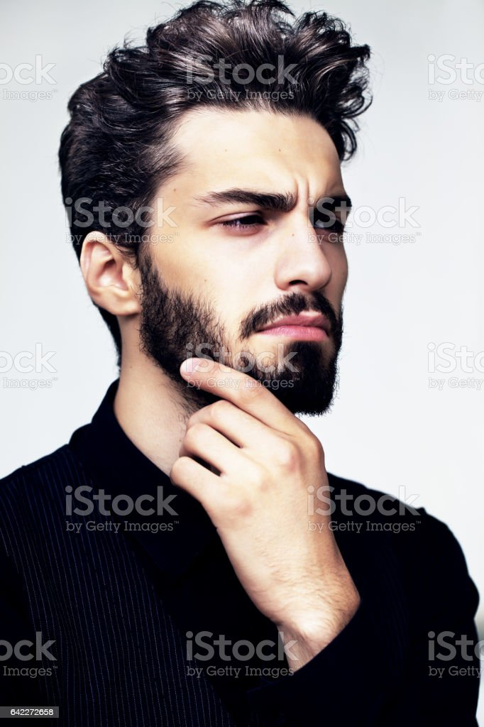 Bearded stylish man posing outdoors stock photo
