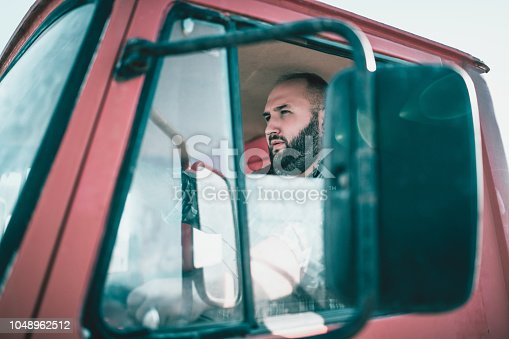 Bearded Truck Driver With Open Window