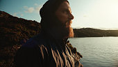 istock Bearded viking man portrait: by a fjord 1304356541