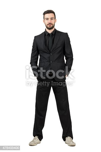 498403166 istock photo Bearded young businessman in white sneakers looking at camera 475403400