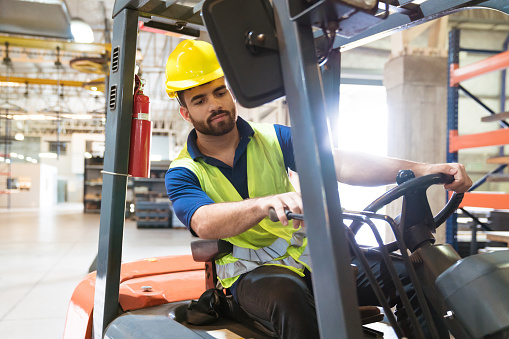 Bearded Young Man Driving Forklift In Factory Stock Photo - Download Image Now