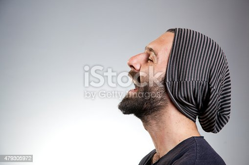 834639402istockphoto Bearded young man laughing 479305972
