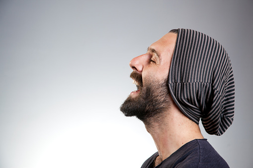 834639402 istock photo Bearded young man laughing 479305972