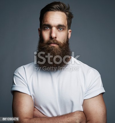611630440 istock photo Bearded young man standing confidently with his arms crossed 881090476
