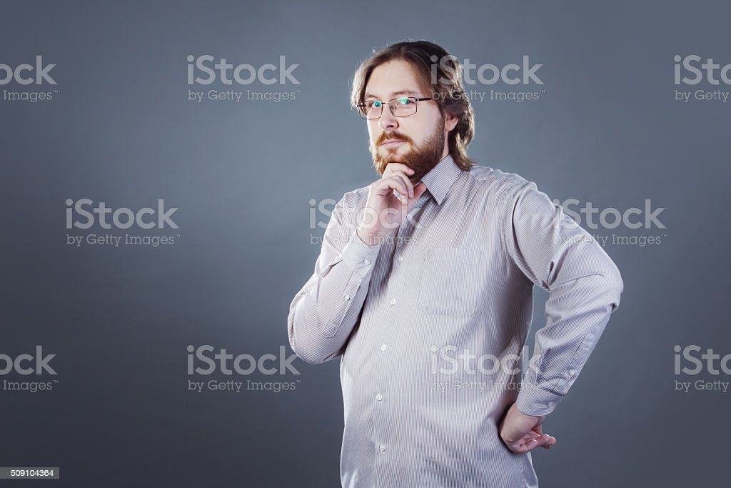 bearded young man with surprised expression stock photo